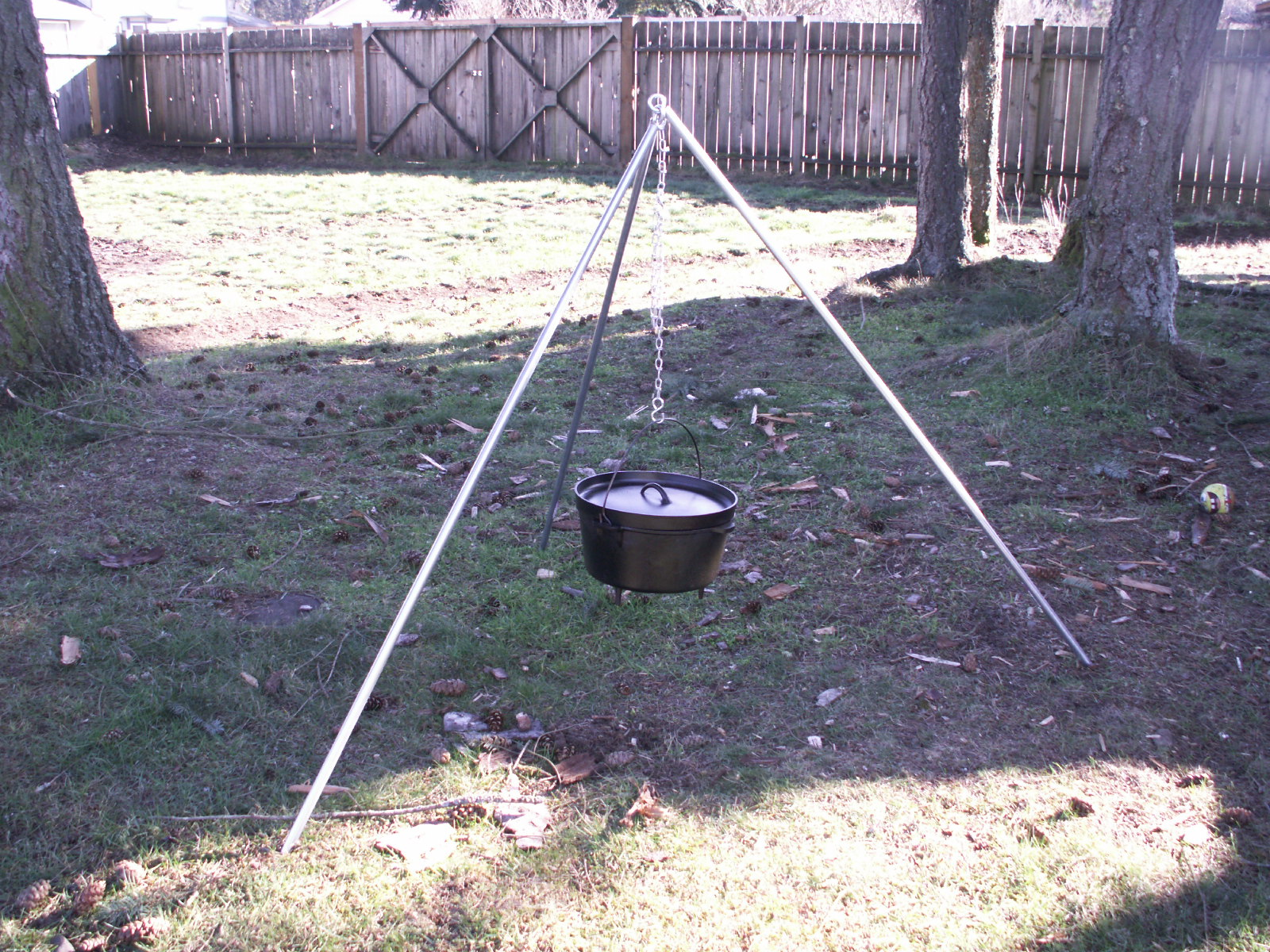 Camping tripod for cooking over fire