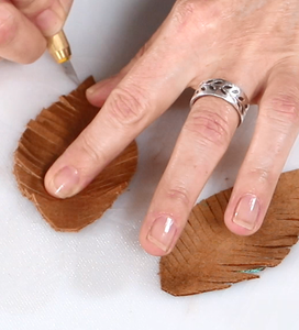 Cut Slits in Leather Feathers