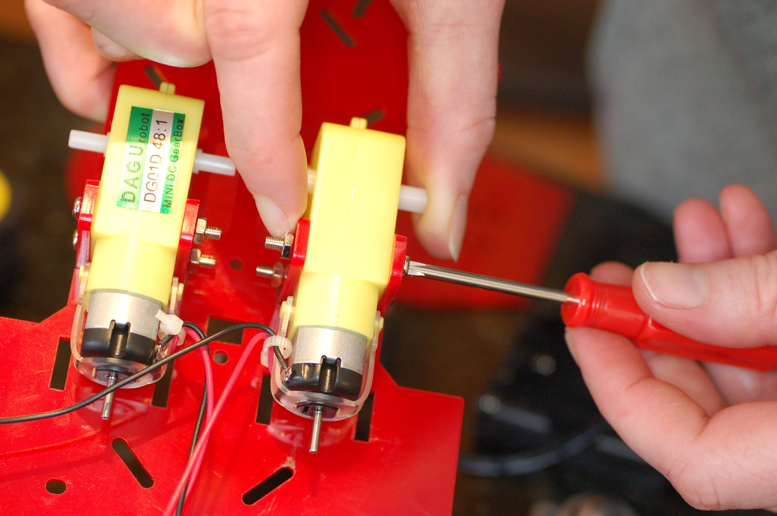 Attach the Motors to the Motor Holders