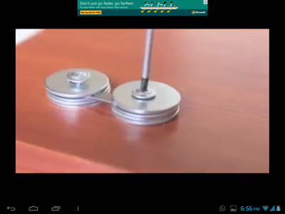 PUT THE SHARPENER BLADE IN THE MIDDLE OF WASHERS AS SHOWN IN THE PICTURE.