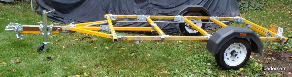 A Homemade Trailer That Is Bolted Together