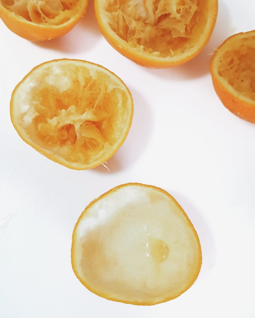 Squeeze Out the Juice and Remove the Membrane Using a Spoon.