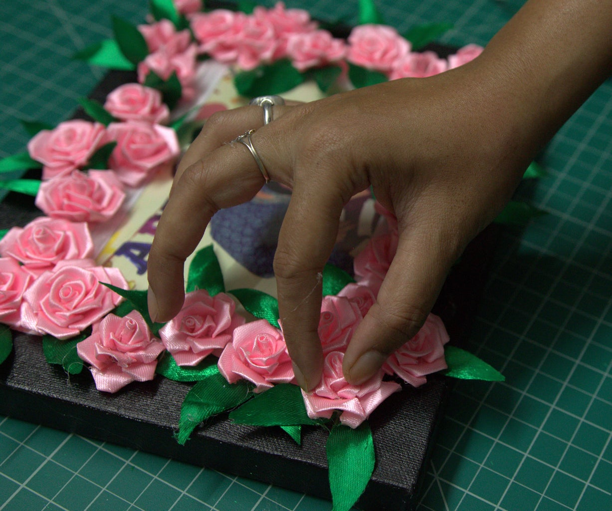 Gluing the Roses on the Frame