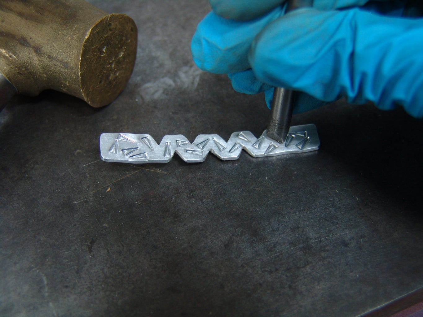 Stamping a Design on the Ring