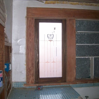 Etched window in unfinished bathroom.jpg