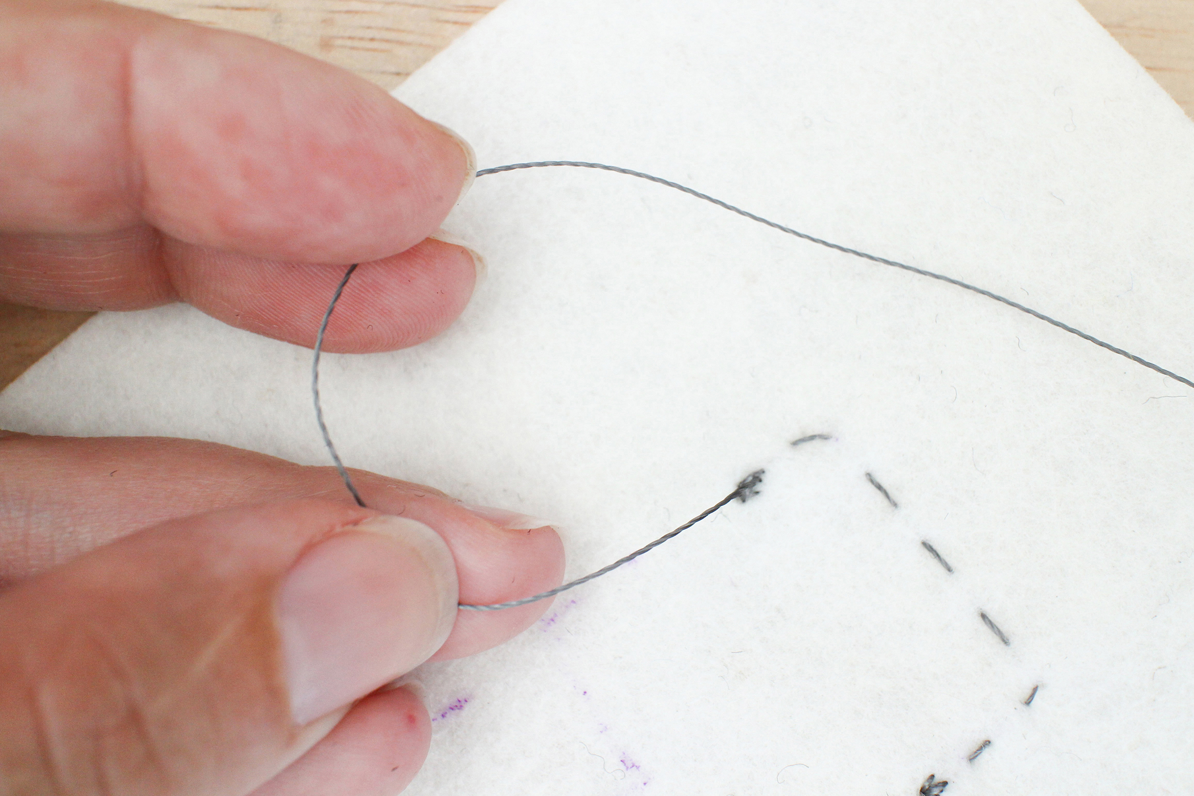 Sew A Circuit Thread Common Schematic Symbols Used In Diagrams Pull The And Guide Knot With Your Hand Down Towards Fabric Leaving Small Loop Place Point Of Needle Middle