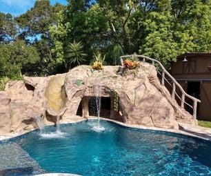 后院池洞穴有幻灯片和热水浴缸。