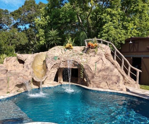 Backyard Pool Grotto With Slide   and Hot Tub.