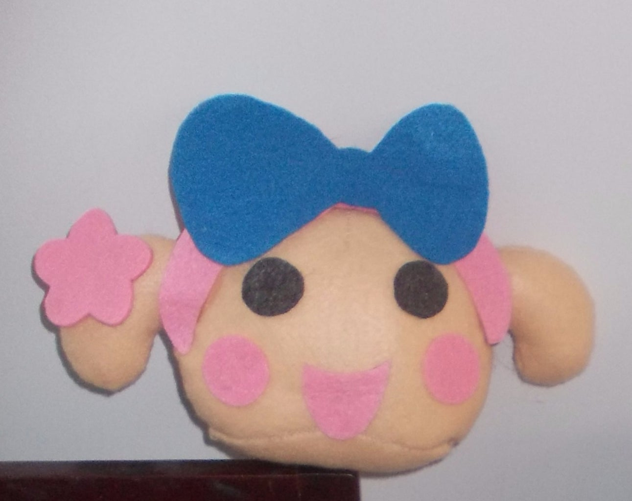 Cut Out the Eyes, Cheeks and Sew Them Like This.