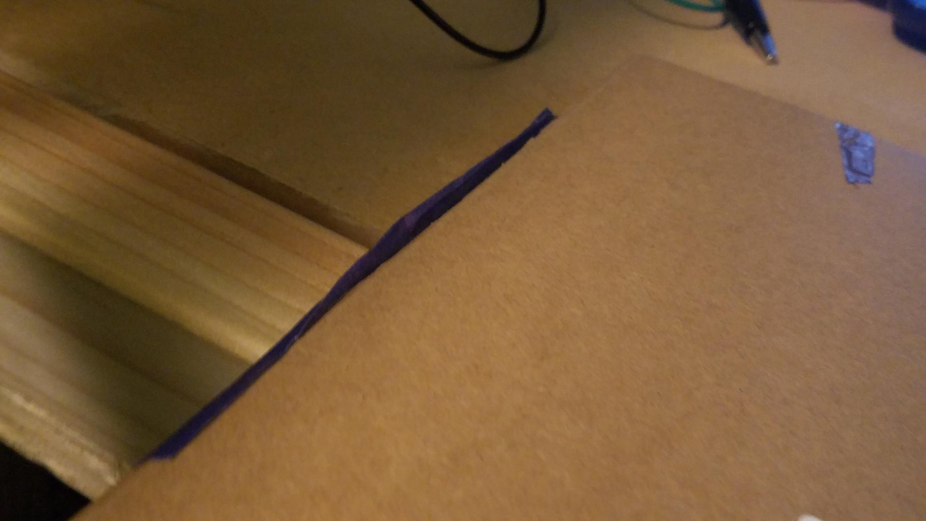 Putting the Foil and Conductive Tape Onto the Cardboard
