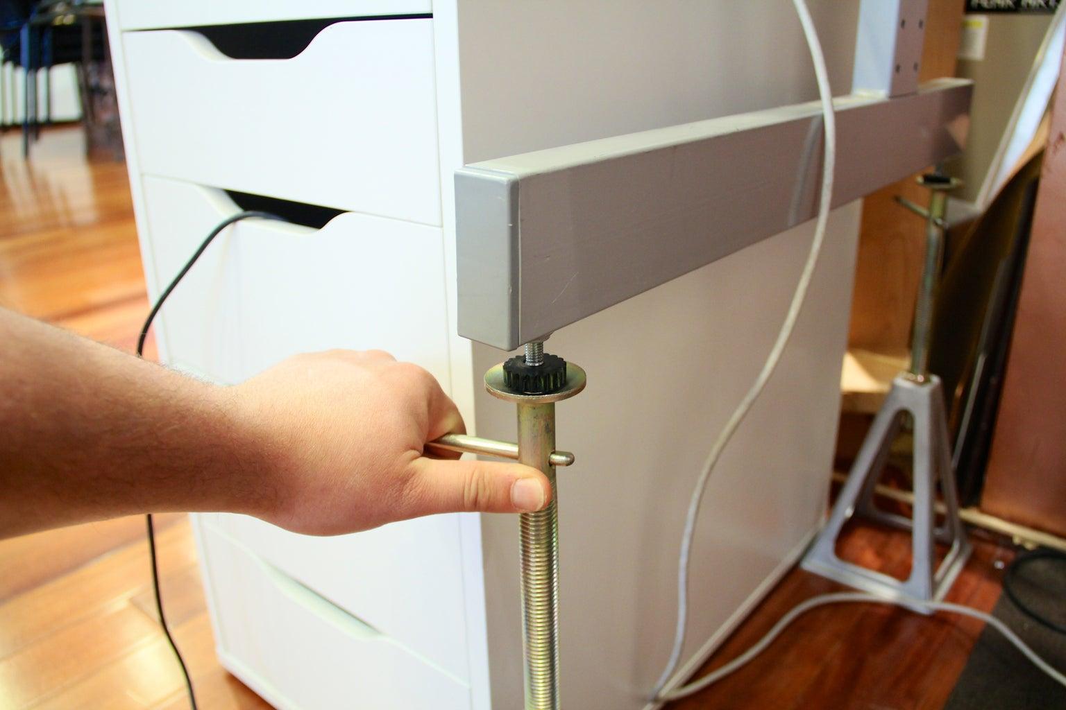 Slide Under Desk and Adjust to Proper Ergonomic Height