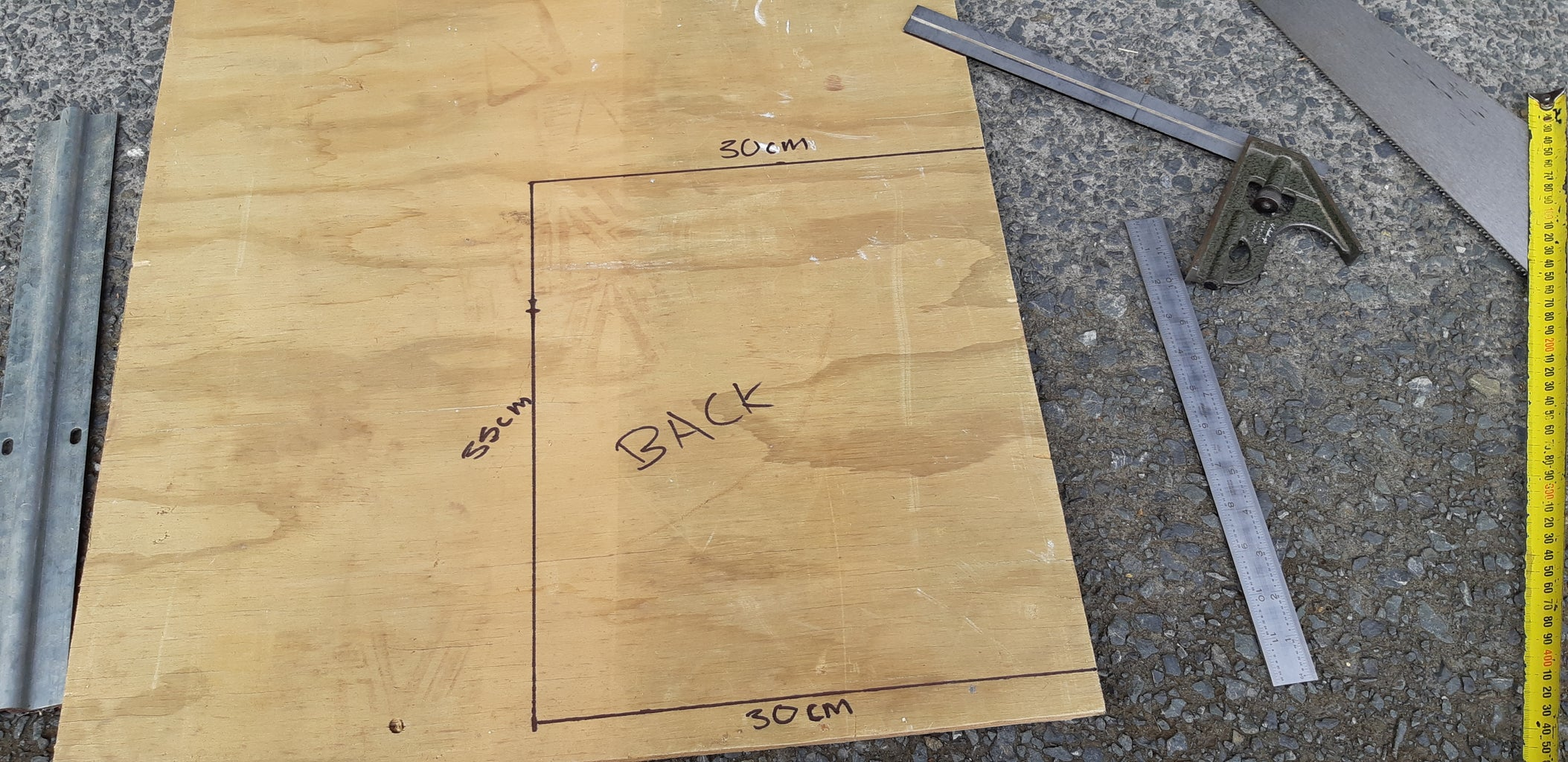 MEASURING AND CUTTING THE PLYWOOD