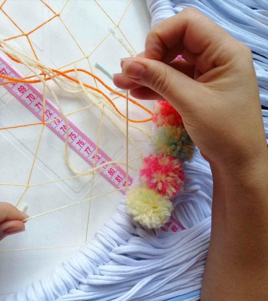 Decorate the Dream Catcher With Pompoms