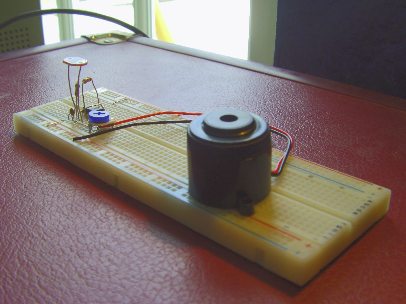"""Dark Detector"" using a 555 timer IC"