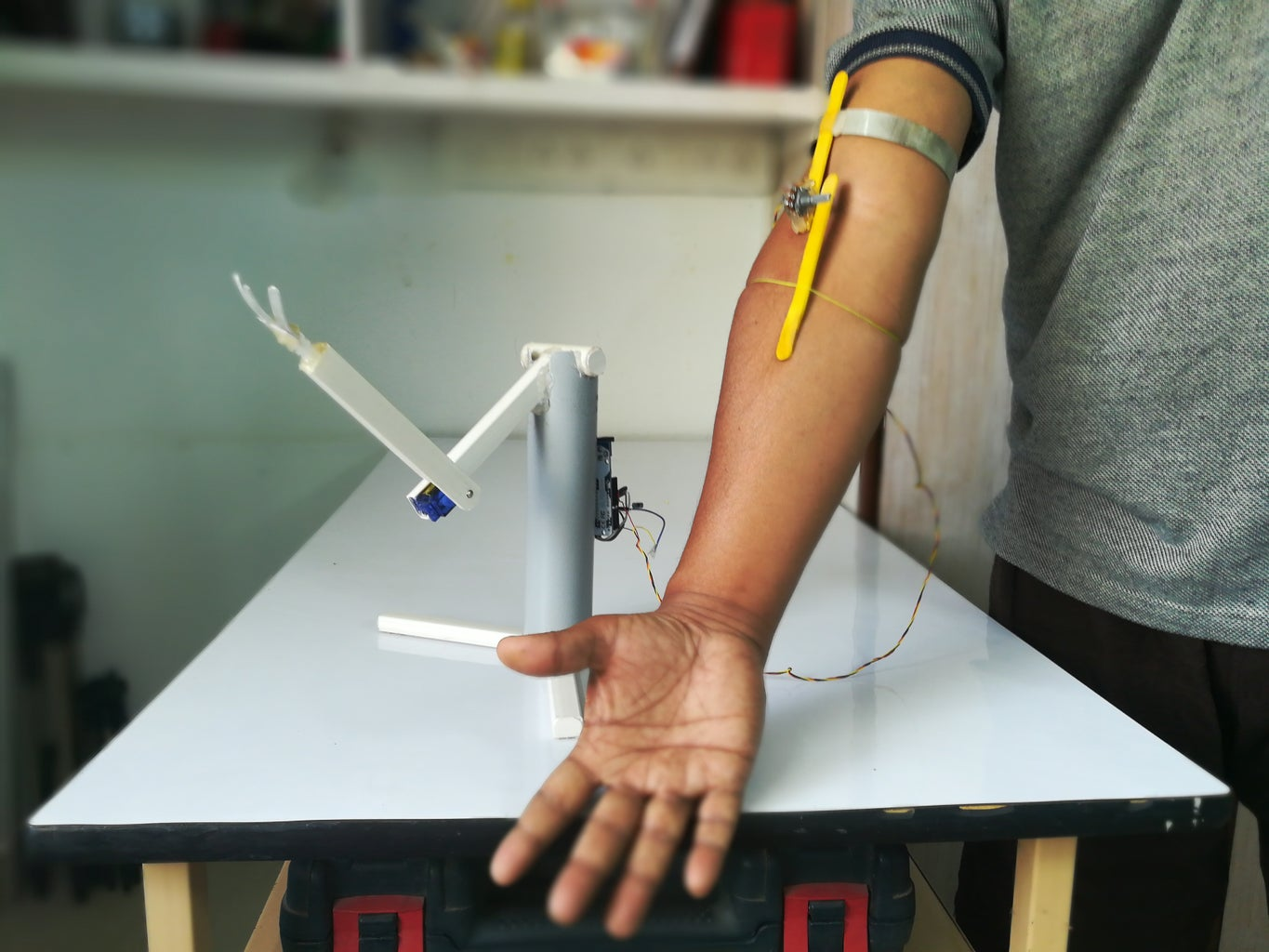 A Simple Robotic Arm Controlled Over Actual Hand Movement