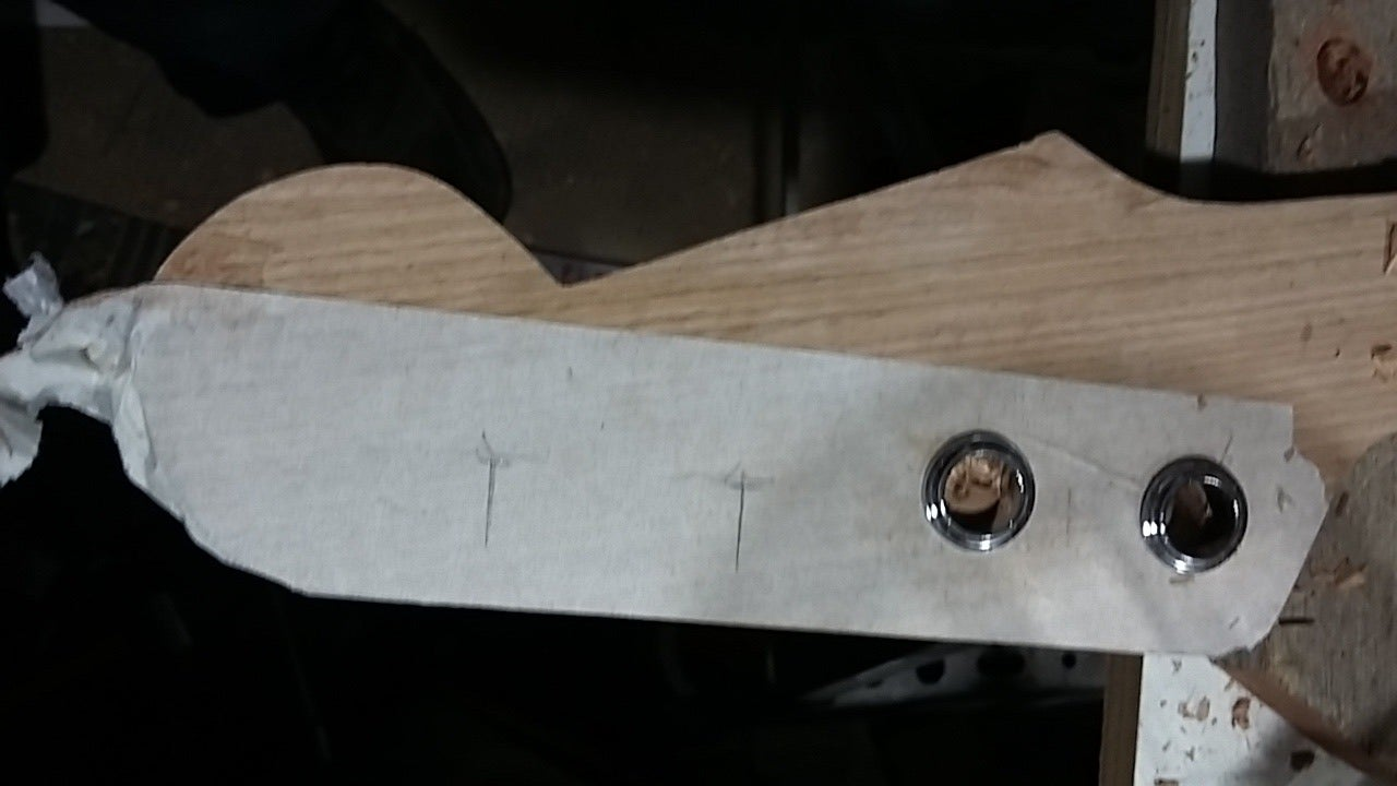 Holes in the Headstock