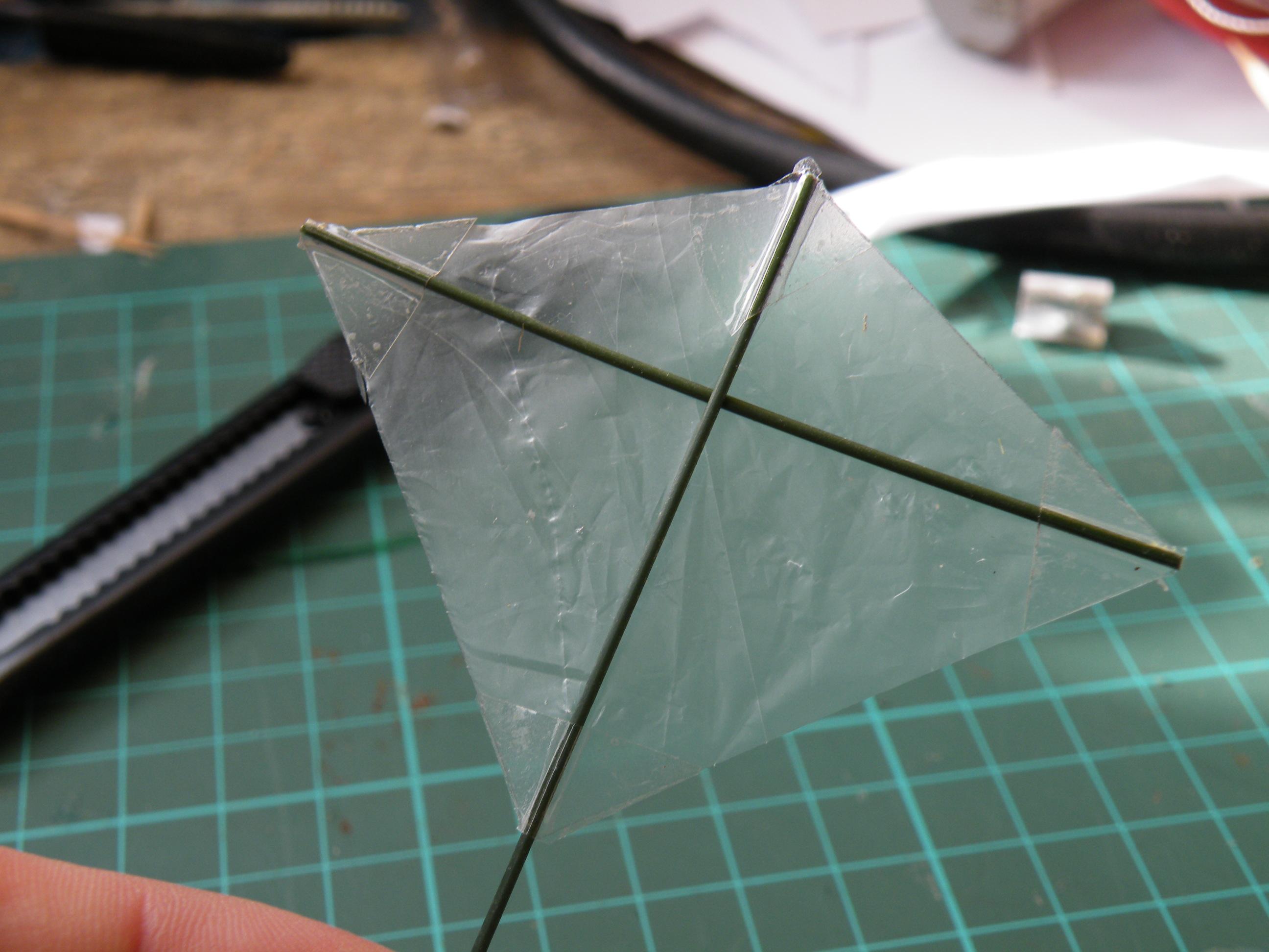 Make a tiny, transparent kite from broom bristles.