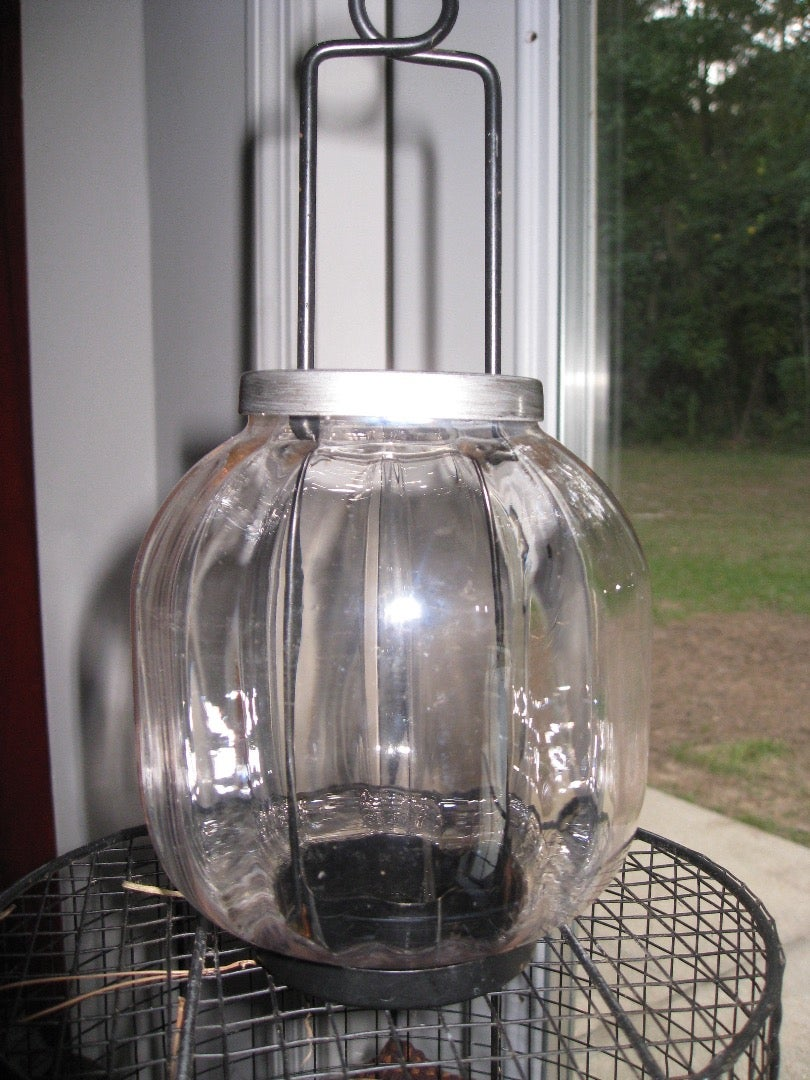 Remove Metal Parts, Paint Those With the Oil Rubbed Bronze. Paint the Entire Glass Globe With Frosted Spray Paint