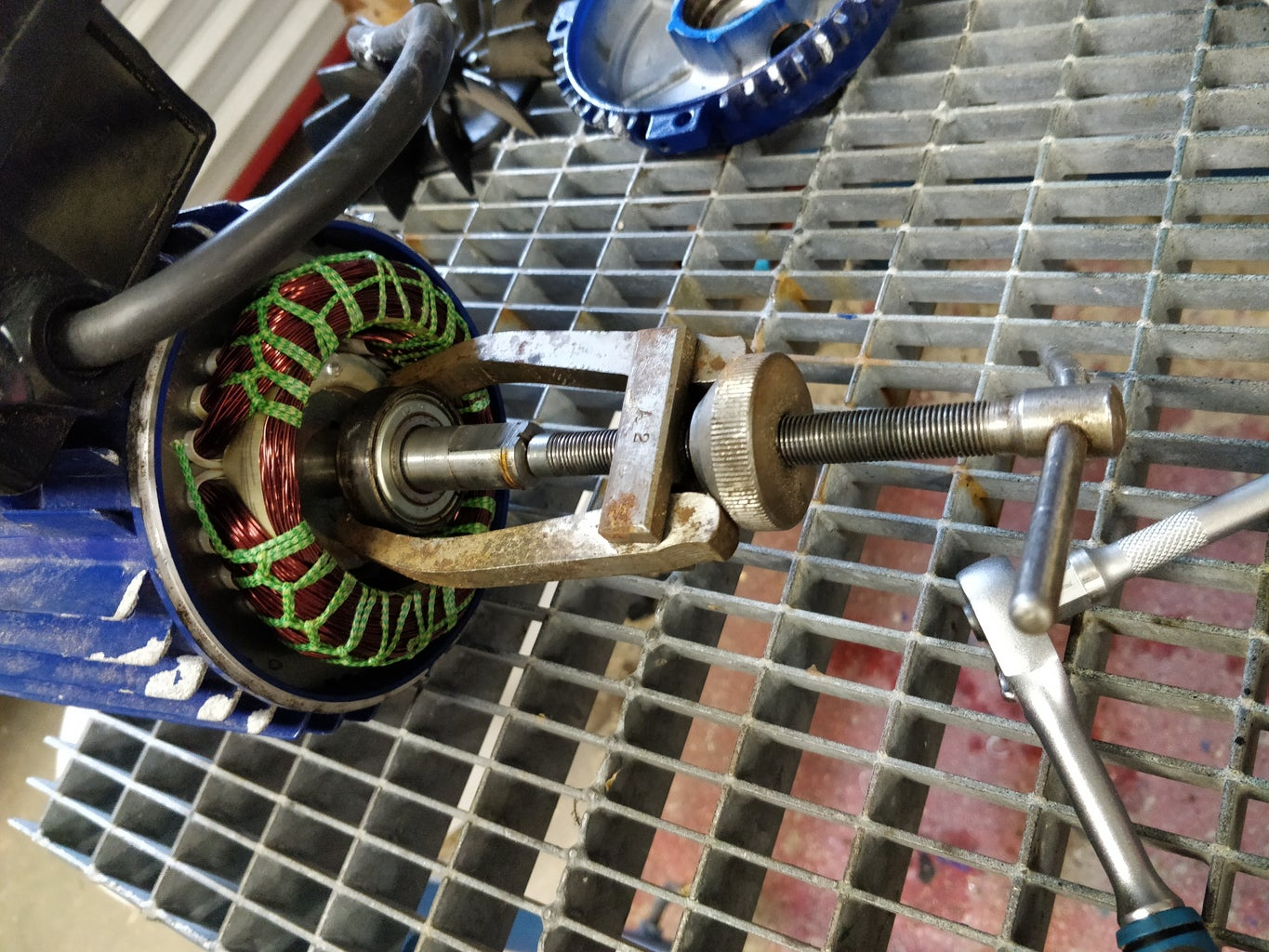 Remove the Motors Rear End Cover, and the Rear Bearing