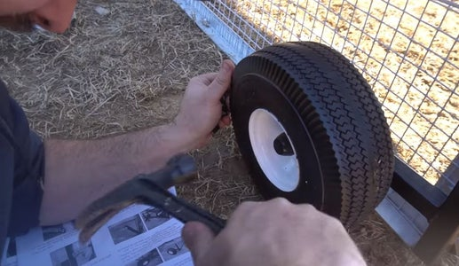 Slide the Wheels Onto the Axles and Secure Them.