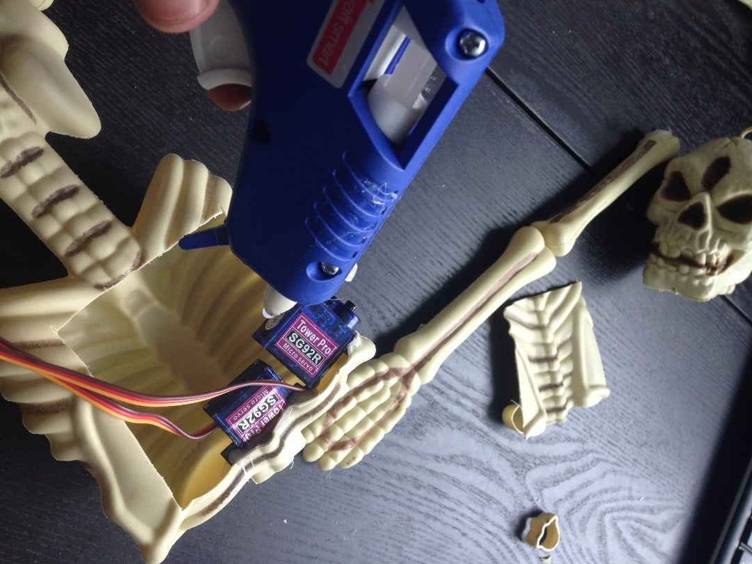 Hotglue the Servos to the Skeleton