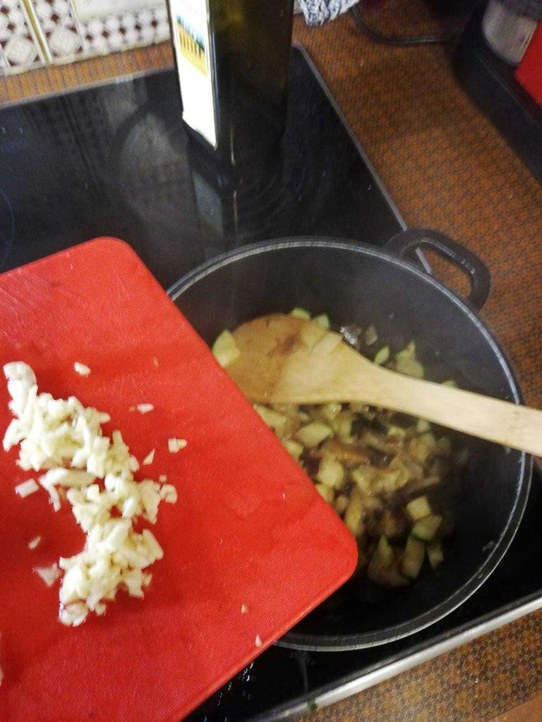 Add Garlic and Tomatoes