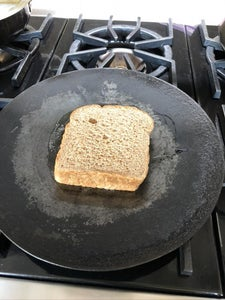 Putting the Bread and Cheese Onto the Skillet