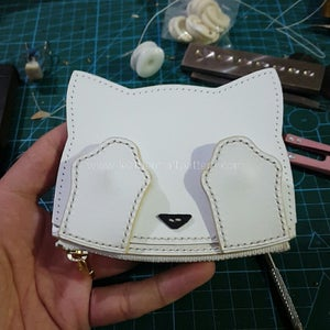 Sew Face on Front Piece, and Sew Left Stitching Holes, Finish.