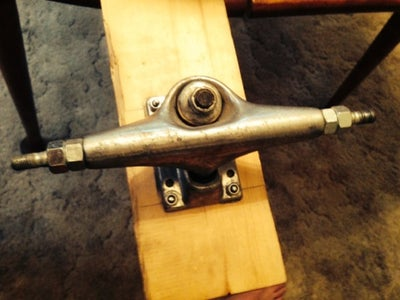 Add 2 Nuts to Axle for Spacers