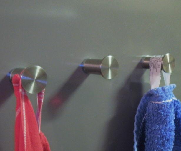 Magnetic kitchen towel hanger