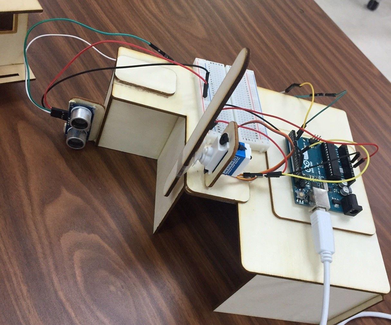 Controlling a Servo With Ultrasonic Sensor Signal Using Arduino ( Automated Gate System )