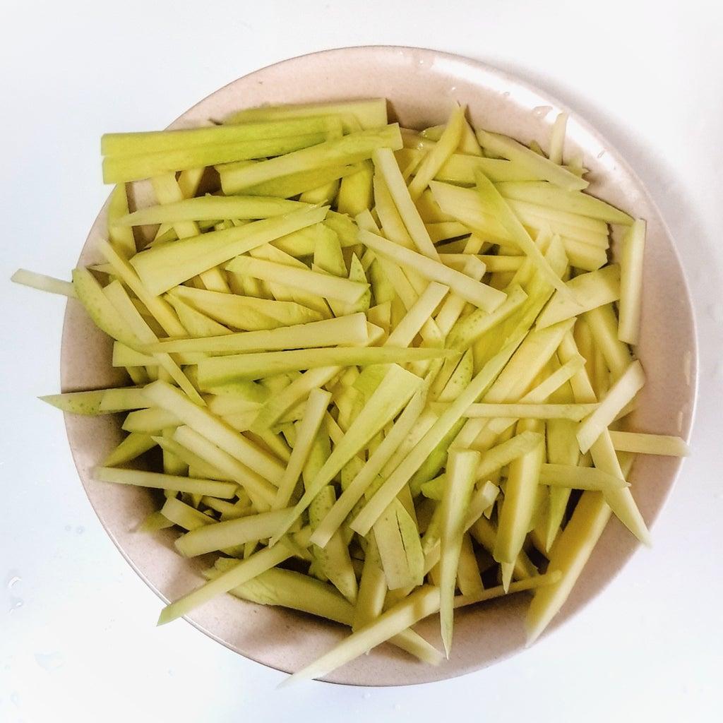 Peel and Slice Mangoes Lengthwise.