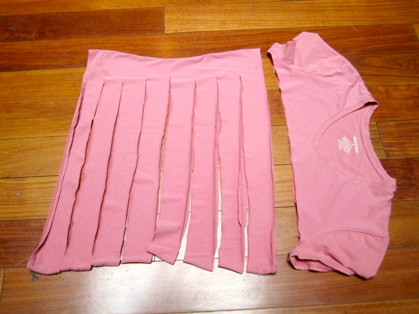 Lay the T-shirt Flat on the Floor and Make the First Cuts
