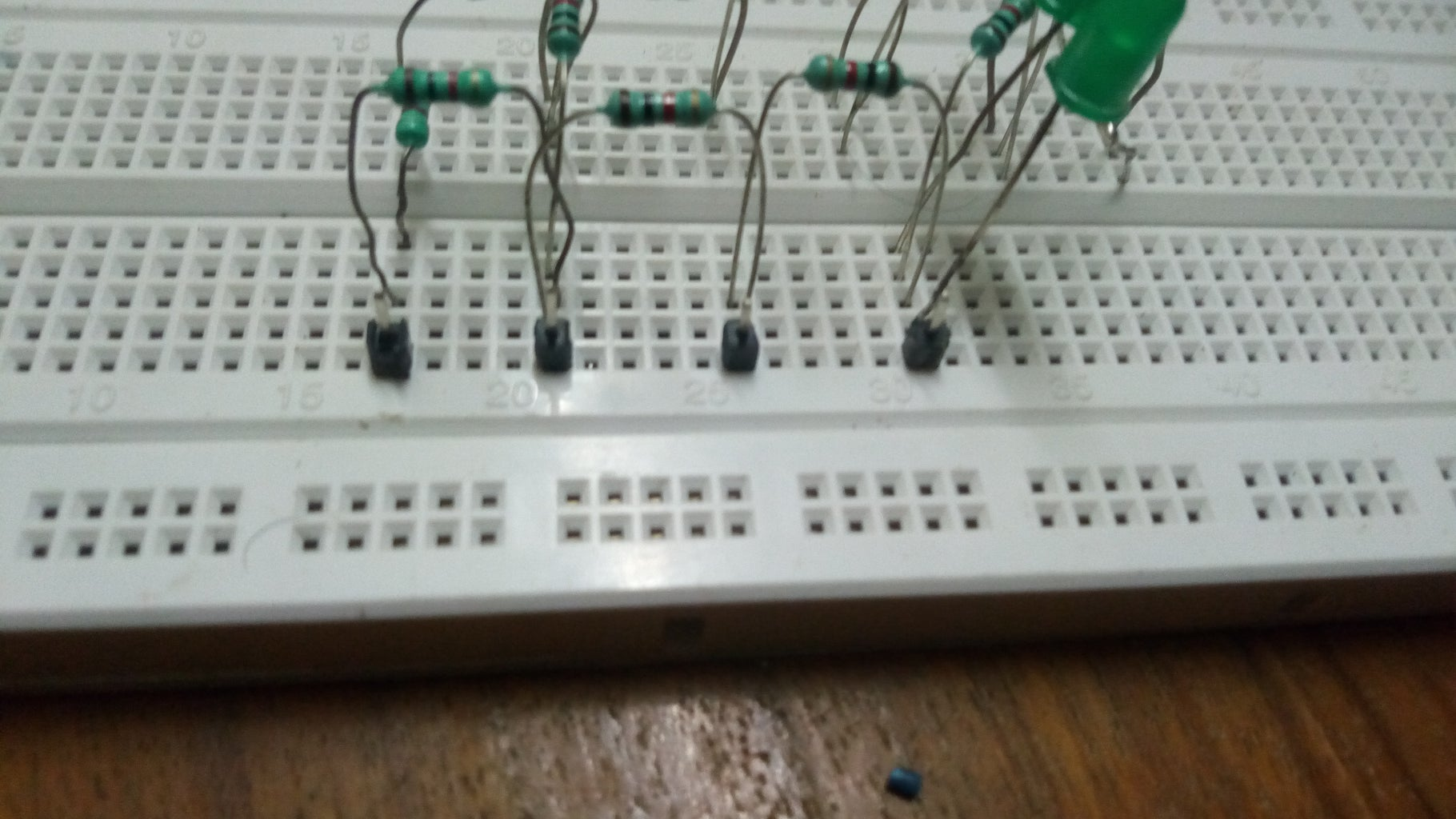 Placing the Four Header Pins on One Side of the Breadboard.