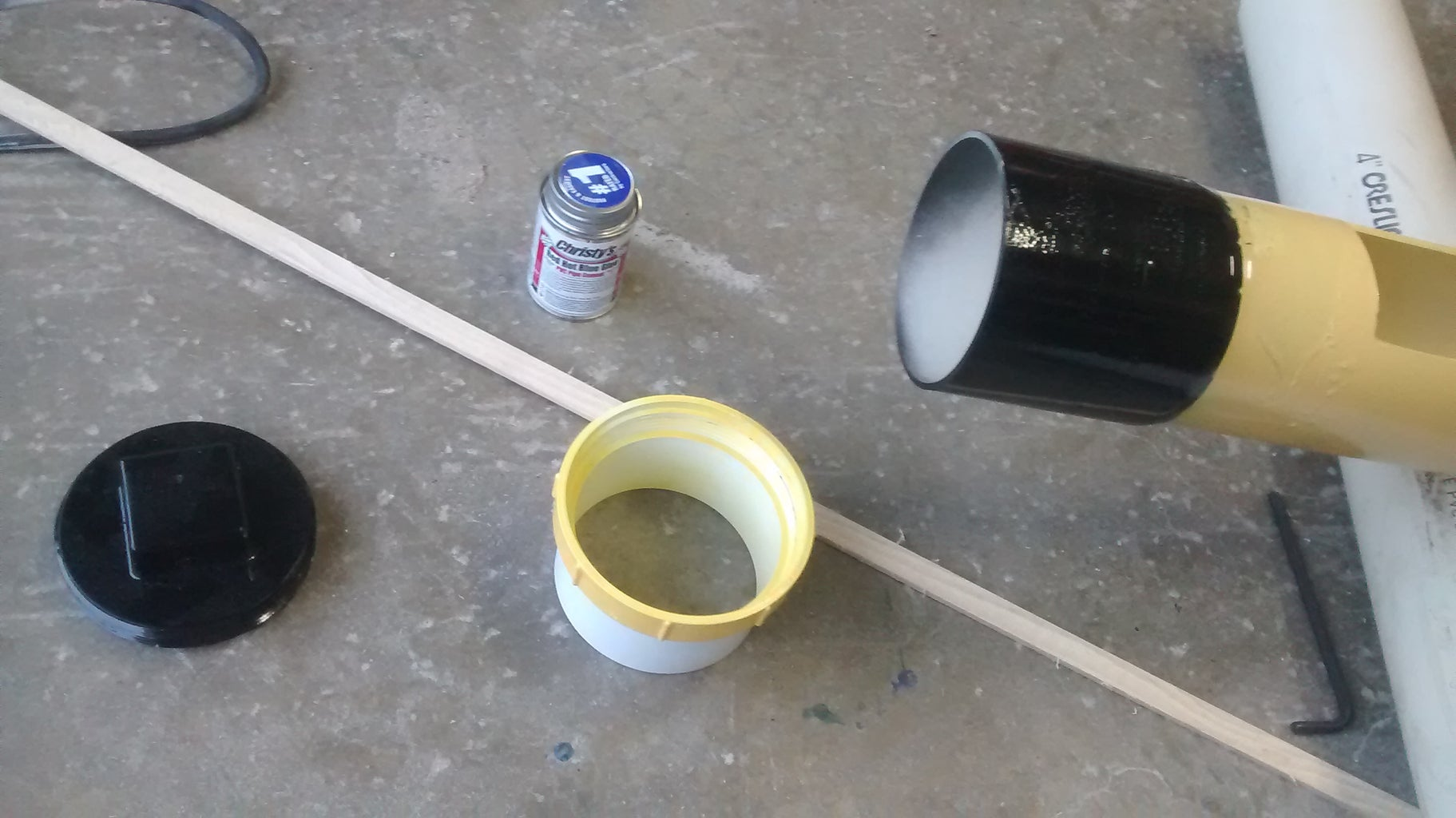 Glue the Float Chamber+Clean Out to the Main Pipe