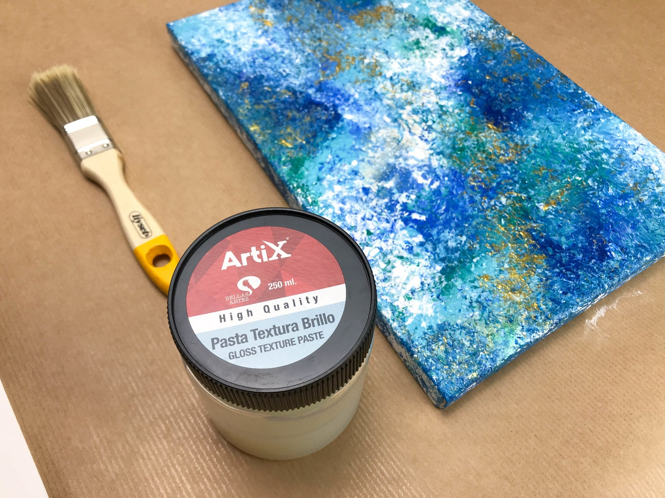 Apply Thin Layer of Glossy Top. Use the Same Technic If You Have Brush Marks on a Canvas