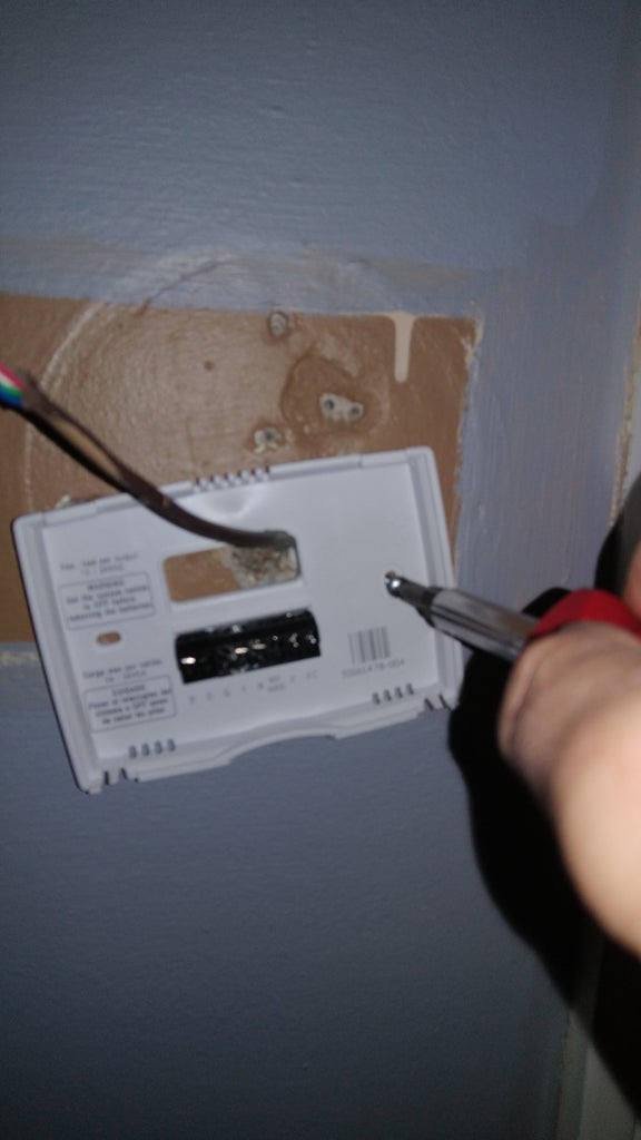 Level Thermostat and Install Screws
