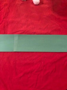 Cut Two Broad Strips From the Paper; Overlap and Glue Across the Middle of the Shirt