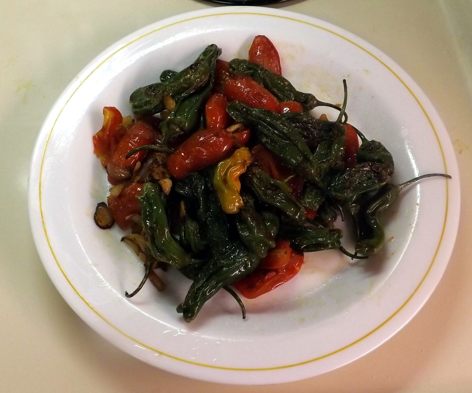 SAUTEED SHISHITO PEPPERS WITH MINI TOMATOES