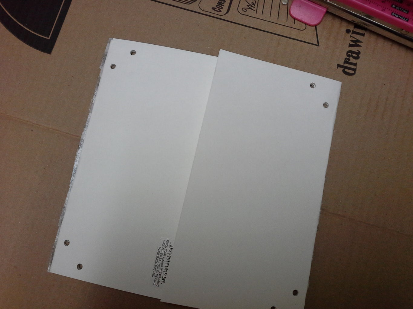 Punch Holes in Panels and Glue Mylar or Foil to Panels.