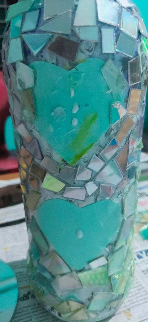 Pasting  Cut Piece  of Cd in the Bottle