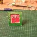 Upcycle a juice carton into a photo frame.