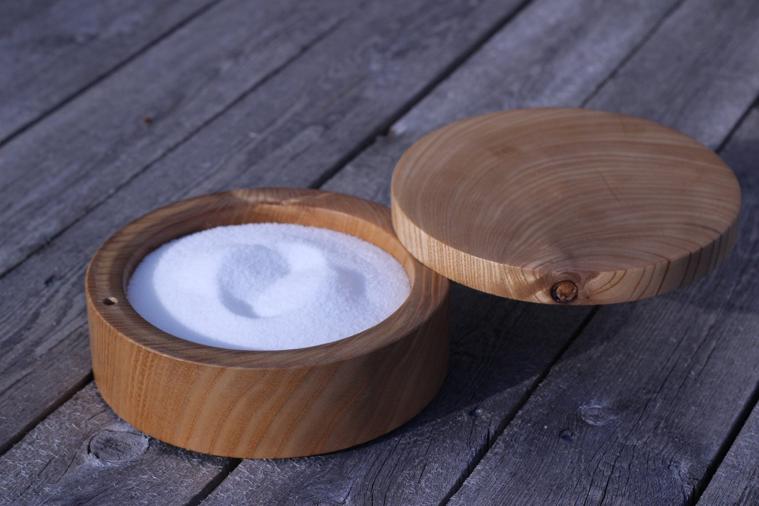 Salt Cellar With a Pivoting Magnetized Lid.