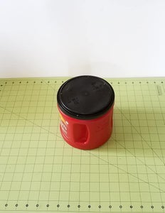Center Your Paper Sacks Over a Coffee Can and Cinch Down the Sides With Both Hands.