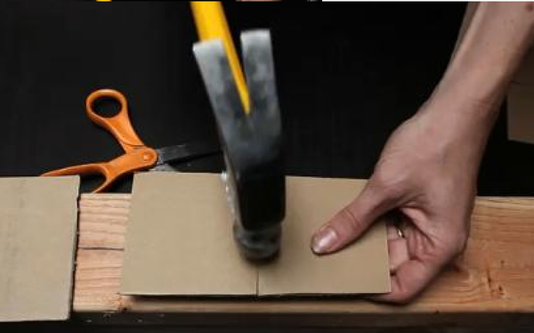 Hammer a Nail Safely With Cardboard