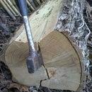 Splitting black locust logs with wedges