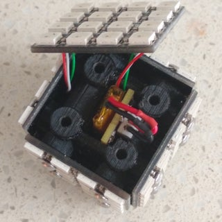 5. Insert board and battery into cube.jpg