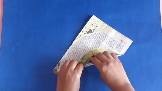 Take a Newspaper and Roll It to Make a Stick.