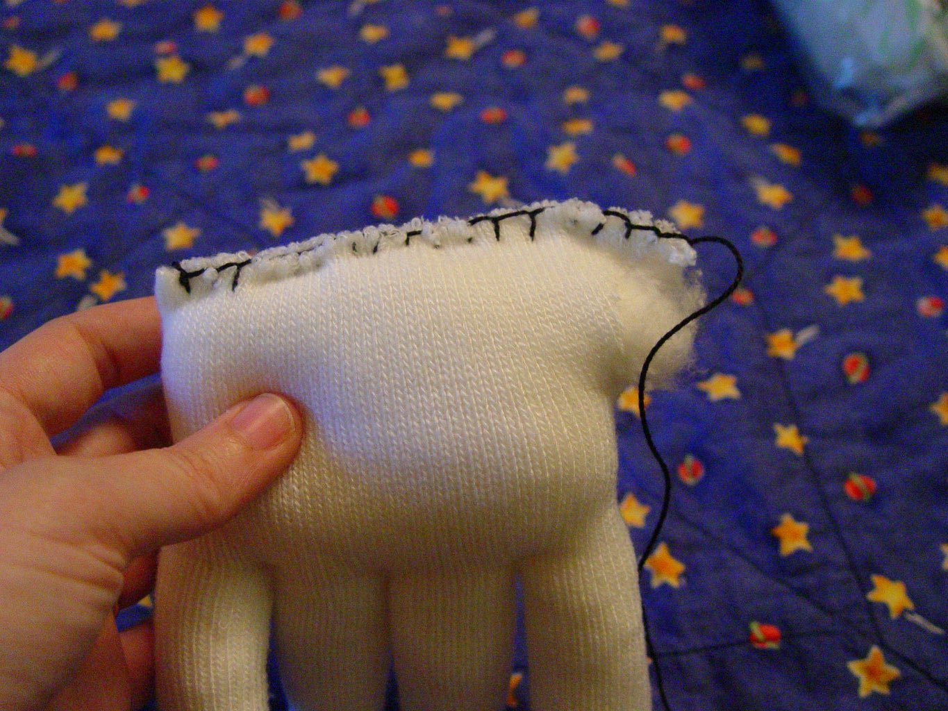Sewing the Head.