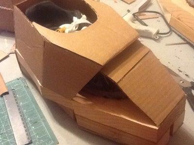 Feet : Cardboard Encasing.